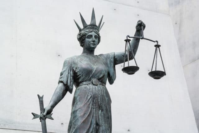 Statue of Themis outside the law courts - Flickr/Rae Allen